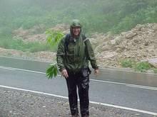 Tony in the rain in North Vietnam